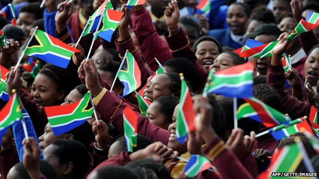 Children in Qunu wave South African flags for Nelson Mandela's 95th birthday (18 July)