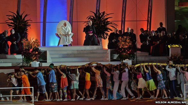 Pope watches as people perform in welcoming ceremony on Copacabana beach