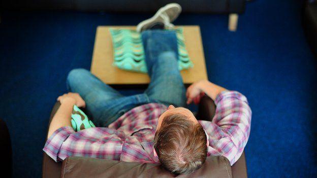 Man relaxing on sofa