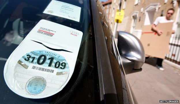 Car tax disc displayed in windscreen