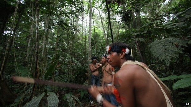 Waorani indigenous youth practice using a blowpipe at the Yasuni National Park in the Upper Napo Valley of the western Amazon region in Ecuador - 2010