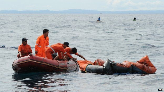 Philippine coast guard personnel search for survivors and dead bodies on floating life rafts from the sunken ferry MV Thomas Aquinas on August 17, 2013