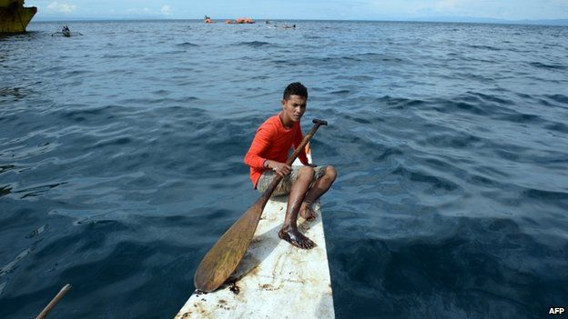 A fisherman with his right foot tainted with oil believed to be from the sunken ferry St. Thomas Aquinas after the ferry collided with a cargo ship near the Philippines' second largest city of Cebu