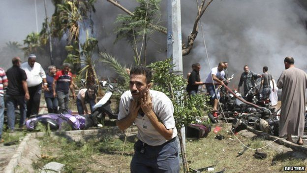 A man reacts outside one of two mosques hit by explosions in Lebanon's northern city of Tripoli, August 23, 2013
