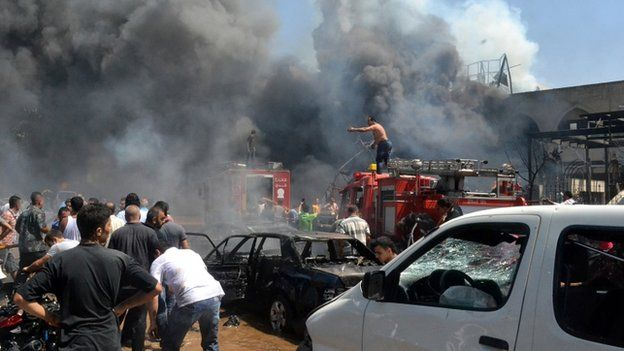Lebanese citizens gather at the site of an explosion outside of a mosque in the northern city of Tripoli, Lebanon, Friday Aug 23, 2013.