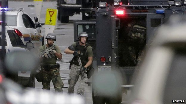 Law enforcement officers respond to a shooting at Washington Navy Yard on 16 September 2013