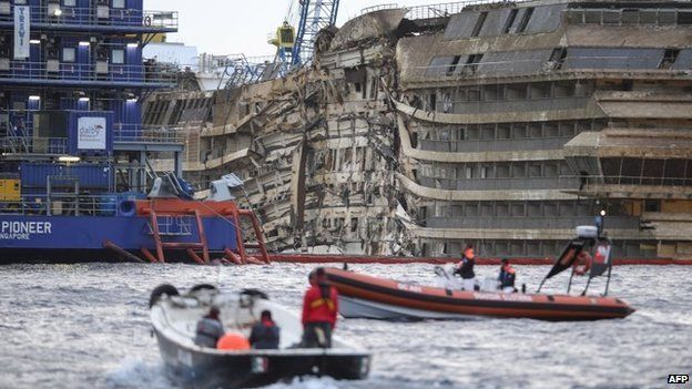 The wreck of Italy's Costa Concordia cruise ship in the early light of 17 September 2013 near Giglio port