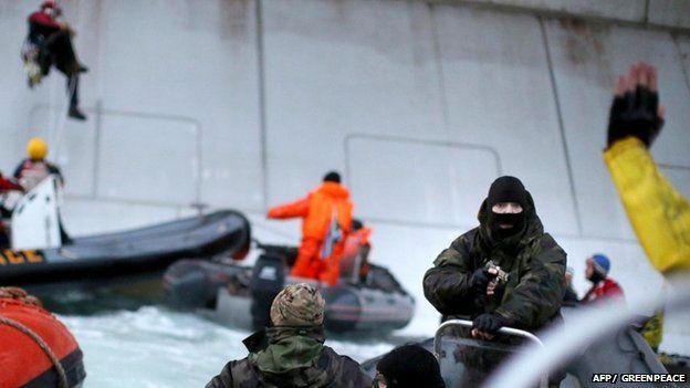 Coastguard points gun at activist on Greenpeace boat