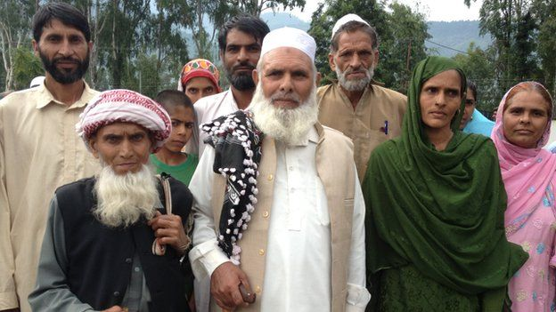 Mohammad Ayub (centre) with his family