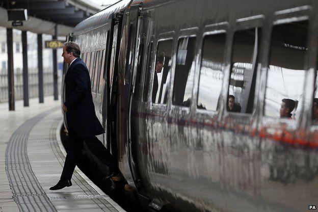 David Cameron alighting from a train