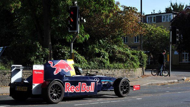 Russ Bost's racing style car waiting at traffic lights