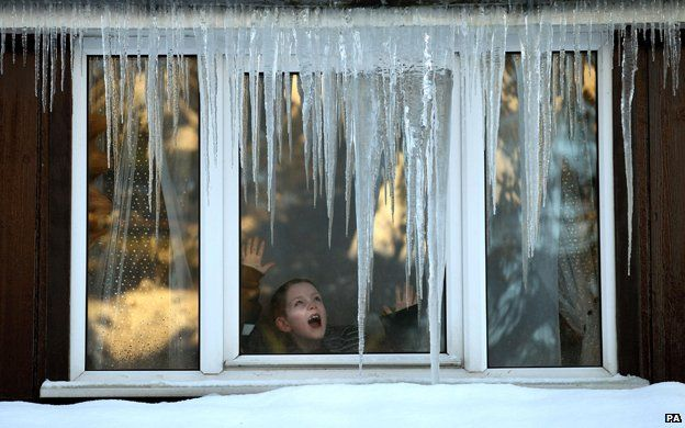 Girl at frosty window