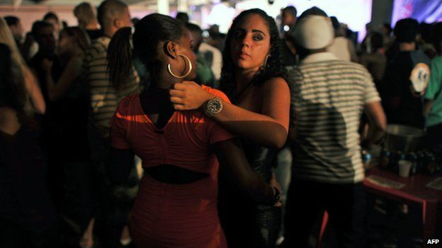 Two girls dance during a funk party at in Rio de Janeiro, on 25 March, 2012