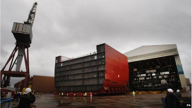 """File photo dated 09/04/12 of a section of the hull of HMS Queen Elizabeth (left) being moved at BAE Systems"""" Govan Shipyard in Glasgow"""