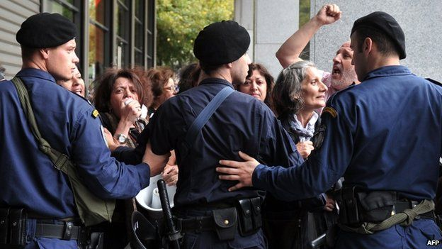 Police block off the Greek finance ministry to protesters in Athens, 5 November