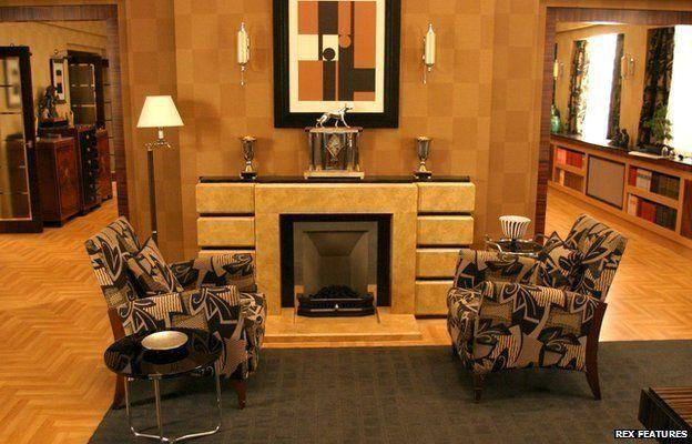 Inside Poirot's flat, including fox clock