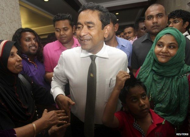 Supporters surround Abdulla Yameen in Male after his election victory in the Maldives, 16 November