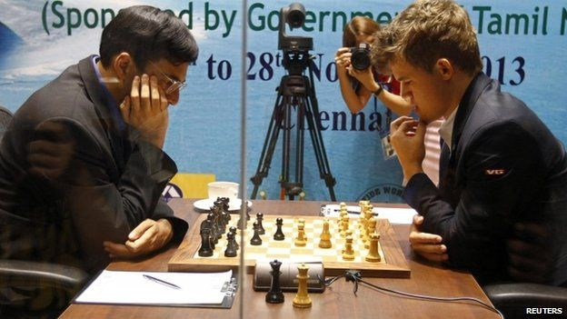 """Norway""""s Magnus Carlsen (R) plays against India""""s Vishwanathan Anand during the FIDE World Chess Championship in the southern Indian city of Chennai November 15, 2013"""