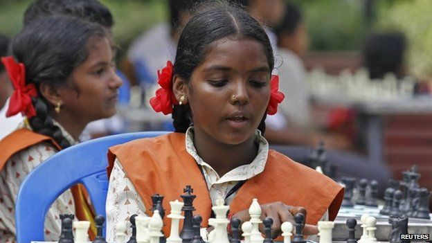 A schoolgirl plays chess in a public park in Chennai
