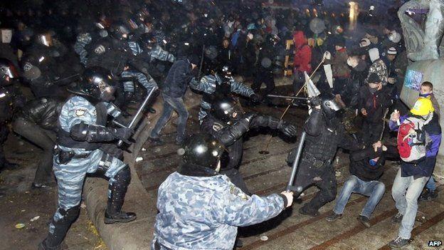 Police charging at protesters in Kiev on 30 November.
