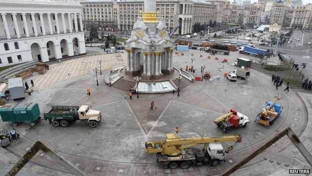 Workers clean up Independence Square in Kiev