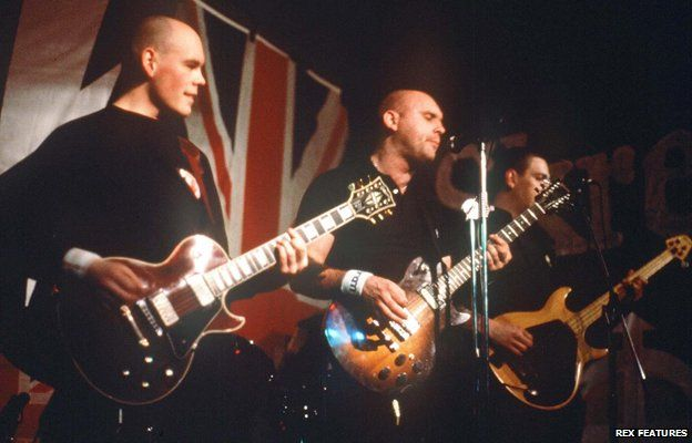 Skrewdriver playing on stage in 1988