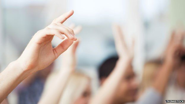 Hands raised in class