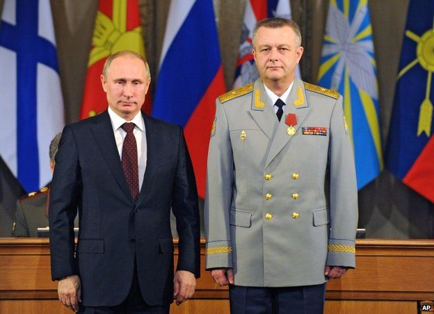 Russian President Vladimir Putin (left) with the Commander of the Russian Military Air and Space Defence Forces, Alexander Golovko, in Moscow, 10 December