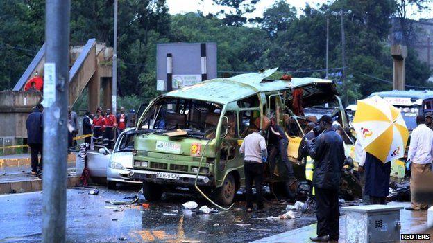 "Damaged vehicles are seen at the scene of a blast near Pangani Police Station in Kenya""s capital Nairobi, December 14, 2013."