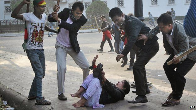 Supporters of the ruling Bangladesh Awami League beat a lawmaker and supporter of the main opposition Bangladesh Nationalist Party (BNP) during a protest by opposition activists in Dhaka, Bangladesh, Sunday, Dec. 29, 2013