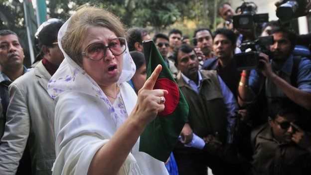 """Bangladesh""""s former Prime Minister and main opposition Bangladesh Nationalist Party (BNP) leader Khaleda Zia gestures as she walks out of her home in Dhaka, Bangladesh, Sunday, Dec. 29, 2013"""