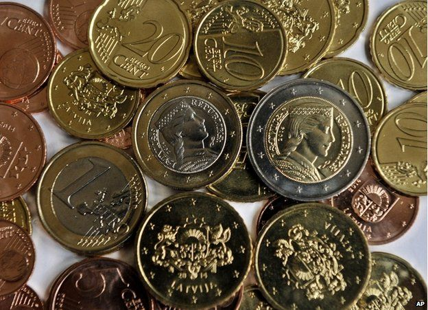 Newly minted Latvian euro coins on display in Riga