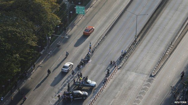 Anti-government protesters block the road at one of major intersections in central Bangkok 13 January 2014