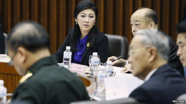 Prime Minister Yingluck Shinawatra (centre) at talks at Royal Thai Air Force Headquarters in Bangkok, 15 January