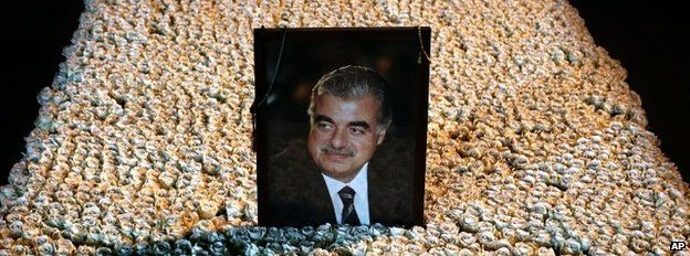 A portrait of slain Lebanese Prime Minister Rafik Hariri sits on his grave which is covered by flowers in central Beirut, Lebanon, on 15 January 2014
