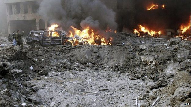 Vehicles burn following a bomb attack that targeted the motorcade of former Prime Minister Rafik Hariri, killing him and 21 others in Beirut, Lebanon, on 14 February 2005 file photo