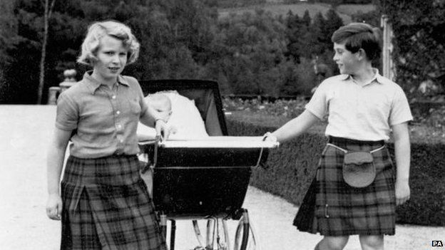 Princess Anne and Prince Charle pulling the pram of baby brother Prince Andrew at Balmoral in 1960