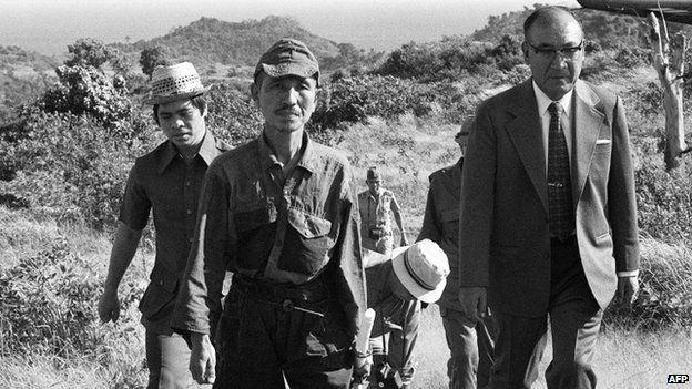 File photo: former Japanese imperial army soldier Hiroo Onoda (second left) walking from the jungle where he had hidden since World War II, on Lubang island in the Philippines, 11 March 1974