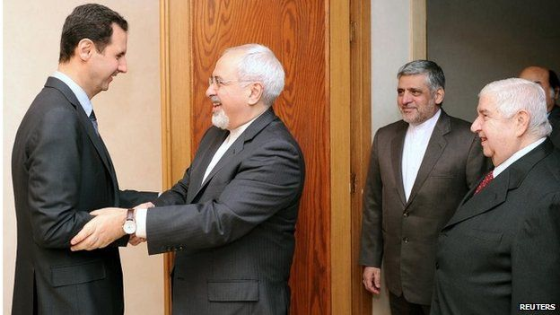 President Bashar al-Assad greets Iranian Foreign Minister Mohammad Javad Zarif in Damascus (15/01/14)