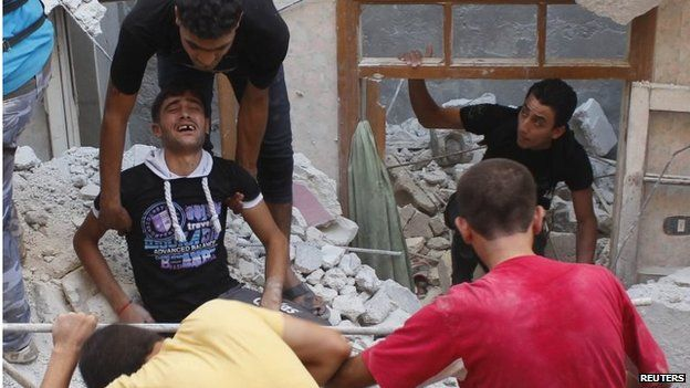 Civilians at site of what activists said was shelling in Aleppo by government forces (file photo)