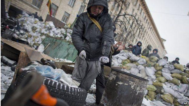 Protester on barricade in Kiev. 28 Jan 2014