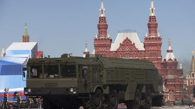 Russian Iskander missiles make their way through Red Square during a rehearsal for the Victory Day military parade in Moscow, Dec 2013