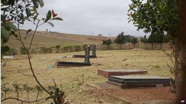 The Mandela family grave in Qunu, right, from where the remains of three family members of former South African president Nelson Mandela were removed by his grandson. A court ordered him to return the remains.
