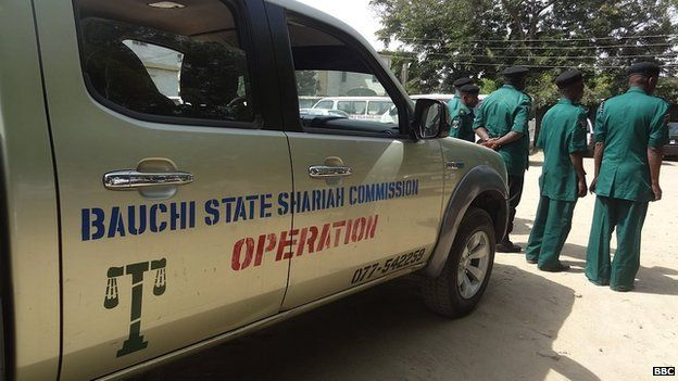 A Bauchi State Sharia Commission vehicle, alongside some officers of the same organisation