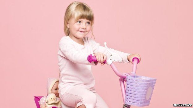 Girl on pink bike