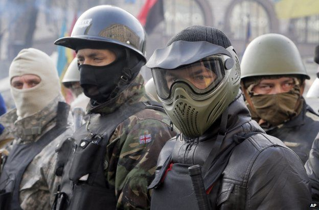 Masked protesters line up in Kiev, 6 February