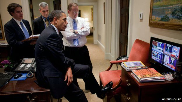 President Barack Obama listens with a group of advisers to a speech by former Egyptian leader Hosni Mubarak