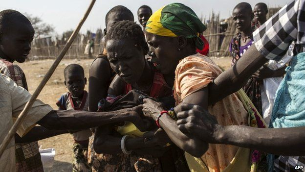 South Sudanese internally displaced people fight for food supplies, distributed by the International Committee of the Red Cross on 9 February 2014
