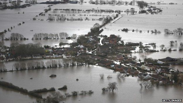 Water surrounds flooded properties in the village of Moorland on the Somerset Levels