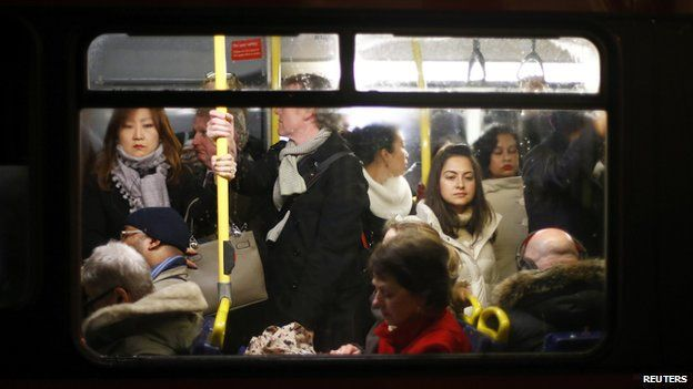 Commuters on a busy bus